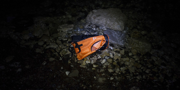 MYTELENE, GREECE - MARCH 09: A life vests floats in the water after an inflatable boat with refugees arrived, crossing the sea from Turkey to Lesbos, some 5 kilometres south of the capital of the Island, Mytelene on March 9, 2016 in Mytelene, Greece. During the night six inflatable baots reached the beaches of Lesbos. Joined Forces of the Standing NATO (North Atlantic Treaty Organisation) Maritime Group 2, including German Navy supply vessel 'Bonn' have arrived at the coast of the greek Island of Lesbos today in order to patrol between the coast of Turkey and Greece. Turkey has announced today to take back illegal migrants from Syria and to exchange those with legal migrants.  (Photo by Alexander Koerner/Getty Images)