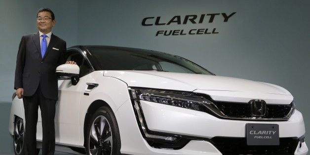 Honda Motor Co. President and Chief Executive Takahiro Hachigo poses for photographers during a press conference in the media preview of the Clarity Fuel Cell at the automaker's headquarters in Tokyo, Thursday, March 10, 2016. Honda has rolled out a new fuel cell vehicle, the first of its kind to be a five-seater. The zero-emissions Clarity may not sell in big numbers, however, given its price tag of 7.66 million yen ($67,000). (AP Photo/Shizuo Kambayashi)