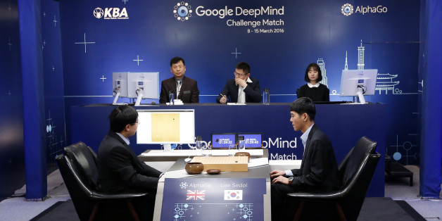 South Korean professional Go player Lee Sedol, right, prepares for his second stone against Google's artificial intelligence program, AlphaGo, as Google DeepMind's lead programmer Aja Huang, left, sits during the second match of the Google DeepMind Challenge Match in Seoul, South Korea, Thursday, March 10, 2016. Google's computer program AlphaGo defeated its human opponent, South Korean Go champion Lee Sedol, on Wednesday in the first face-off of a historic five-game match. (AP Photo/Lee Jin-man