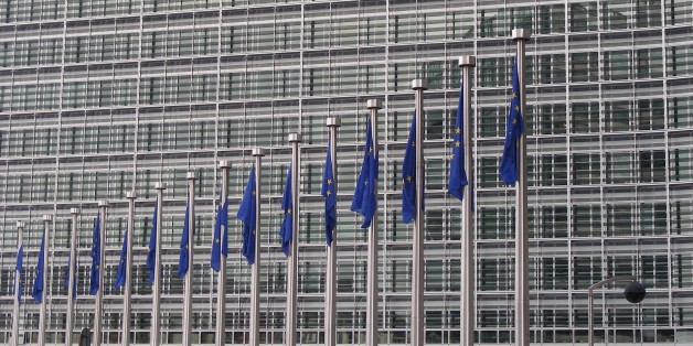 There are many EU flags in front of the European Commission building in Brussels. The building is huuuuge. I wonder how many offices are in it.