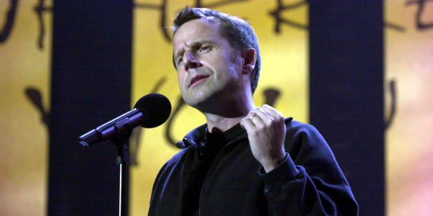 Comedian Jeremy Hardy performing on stage during the 'We Know Where You Live. Live!' event to mark the 40th anniversary of Amnesty International at Wembley Arena.