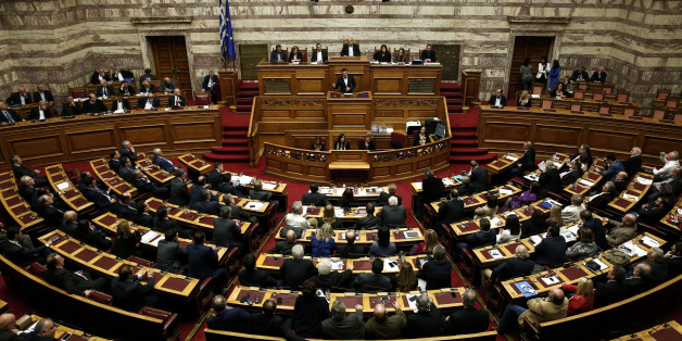 Greece's Prime Minister Alexis Tsipras addresses lawmakers during a parliamentary session in Athens, Sunday, Dec. 6, 2015. Greek parliament votes on 2016 budget that sees the country slipping back into mild recession and maintaining high unemployment. (AP Photo/Yorgos Karahalis)