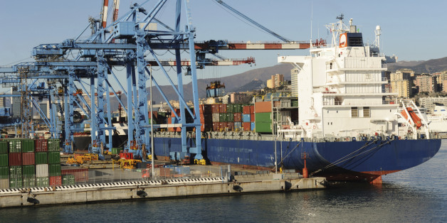'Large modern container boat arriving at the dock, several elevators ready for unloading, Genoa, Italy'
