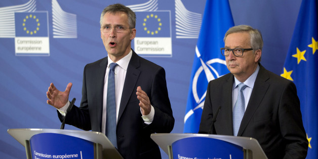 NATO Secretary General Jens Stoltenberg, left, participates in a media conference with European Commission President Jean-Claude Juncker at EU headquarters in Brussels on Thursday, March 10, 2016. NATO Secretary General Jens Stoltenberg visited EU headquarters on Thursday to discuss the current migration crisis.(AP Photo/Virginia Mayo)