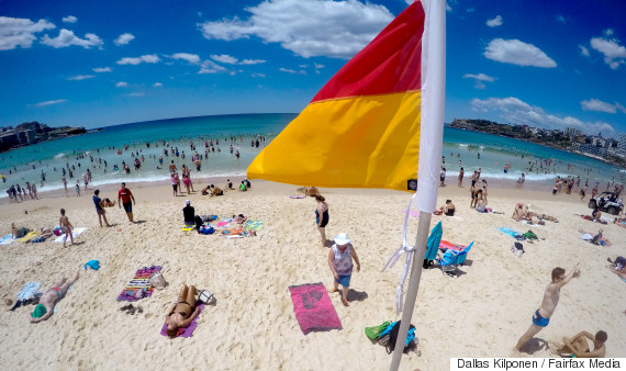 flags beach red yellow
