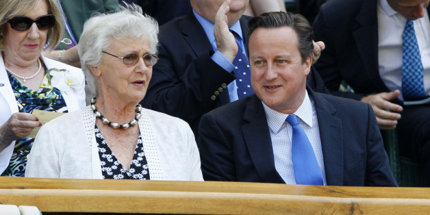 Britain's Prime Minister David Cameron, front right, and his mother Mary arrive to watch Andy Murray of Britain face Novak Djokovic of Serbia in the Men's singles final match at the All England Lawn Tennis Championships in Wimbledon, London, Sunday, July 7, 2013