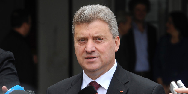 Macedonia's incumbent President Gjorge Ivanov talks to the media after casting his ballot for the elections, in Skopje, Macedonia, Sunday, April 27, 2014. Polls opened for Macedonia's double election, a presidential election runoff and snap national elections. Conservatives are favored to win both contests. (AP Photo/Boris Grdanoski)