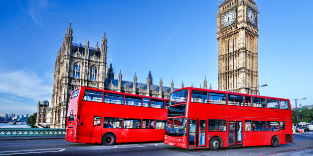 Famous Big Ben with red buses in  London, England, UK