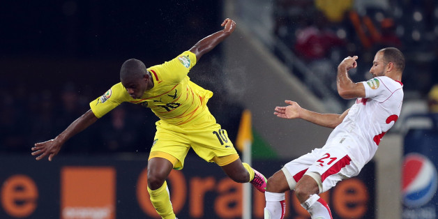 Togo's Floyd Ayite, left, is challenged by Tunisia's Khaled Mouelhi, right, during their African Cup of Nations Group D soccer match at Mbombela Stadium in Nelspruit, South Africa, Wednesday Jan. 30, 2013. (AP Photo/Themba Hadebe)