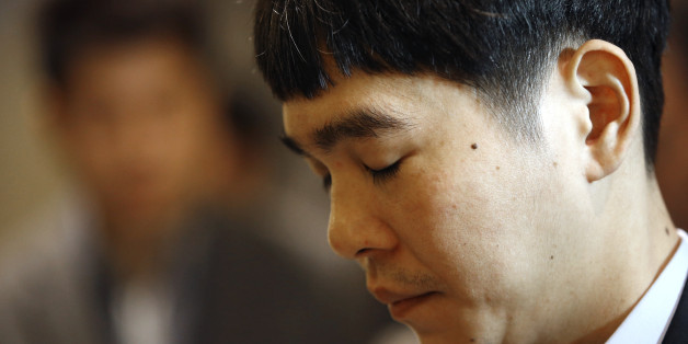 South Korean professional Go player Lee Sedol waits before entering the venue for the third match of the Google DeepMind Challenge Match against Google's artificial intelligence program, AlphaGo, in Seoul, South Korea, Saturday, March 12, 2016. (AP Photo/Lee Jin-man)