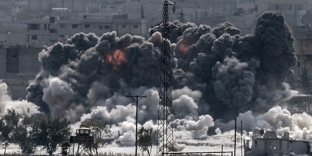A picture taken from the Turkish border near the southeastern village of Mursitpinar, in the province of Sanliurfa shows smoke billowing after a jet fighter hit Kobane, also known as Ain al-Arab, on October 28, 2014. Turkey wants the anti-Damascus Free Syrian Army (FSA) to control the Syrian border town of Kobane if Islamist jihadists are defeated, and not the forces of separatist Kurds or President Bashar al-Assad, Prime Minister Ahmet Davutoglu said. Turkey is fearful that Kobane could be taken over by Kurds  allied to the Kurdistan Workers' Party (PKK) which has waged a three-decade insurgency for self rule and is regarded as a terrorist group by Turkey, the United States and most of Europe.AFP PHOTO/STRINGER        (Photo credit should read STR/AFP/Getty Images)