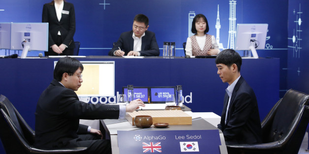 South Korean professional Go player Lee Sedol, right, watches as Google DeepMind's lead programmer Aja Huang, left, puts the Google's artificial intelligence program, AlphaGo's first stone during the final match of the Google DeepMind Challenge Match in Seoul, South Korea, Tuesday, March 15, 2016. A champion Go player scored his first win over a Go-playing computer program on Sunday after losing three straight times in the ancient Chinese board game, saying he finally found weaknesses in the software. (AP Photo/Lee Jin-man)