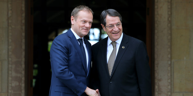 European Council President Donald Tusk, left, shakes hands with Cyprus President Nicos Anastasiades at the Presidential Palace before their meeting in the ethnically divided island's capital Nicosia on Tuesday, March 15, 2016. Tusk is in Cyprus to sound out the Cypriot president on unblocking Turkey's EU accession negotiations in order to clinch a sought-after deal with Ankara on stemming the flow of migrants into the continent. (AP Photo/Petros Karadjias)