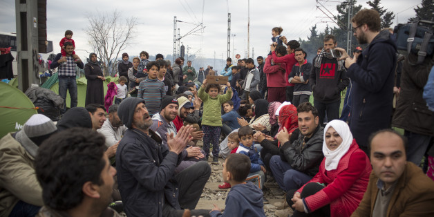 IDOMENI, GREECE - 2016/03/12: Thousands of refugees from Syria are locked in Idomeni on the border between Greece and Macedonia. The borders are closed, the hygienic and sanitary conditions are poor, many volunteers are helping in every way there're thousands of men, women and children stuck between the railroad tracks. (Photo by Davide Bosco/Pacific Press/LightRocket via Getty Images)