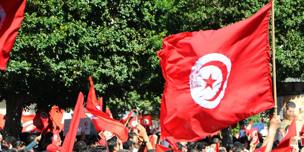 A crowd invades the streets during a demonstration to celebrate Tunisia's independence, Tuesday, March, 20, 2012 in Tunis. On March 20, 1956, Tunisia achieved independence from France  led by Habib Bourguiba, who became the first President of the Republic of Tunisia. (AP Photo/Hassene Dridi)