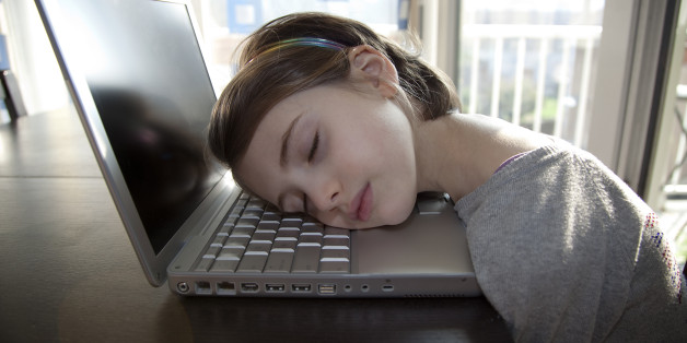 Young girl (5 years old) sleeping on laptop computer