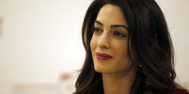 British lawyer Amal Clooney attends a press conference with former Maldives president Mohamed Nasheed in London, Monday, Jan. 25, 2016. President Nasheed is the first democratically-elected leader of his country and a renowned champion for human rights and climate justice. In March 2015, he was sentenced to 13 years' imprisonment in the Maldives by the authoritarian regime of Abdulla Yameen, the half-brother of a former dictator. (AP Photo/Alastair Grant)