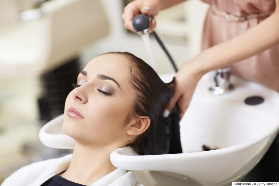 woman washing hair at salon
