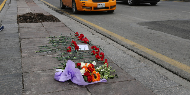 Flowers left by local people at Sunday's explosion site in Ankara, Turkey, Tuesday, March 15, 2016. Turkey on Tuesday identified the attacker who carried out a deadly suicide bombing in Ankara as a 24-year-old woman who allegedly joined the Kurdish rebel group in 2013 and trained in Syria. An Interior Ministry statement identified the suicide car bomber blamed for killing 37 people, including herself, on Sunday as Seher Cagla Demir. A possible male accomplice, who was also killed, has not yet be
