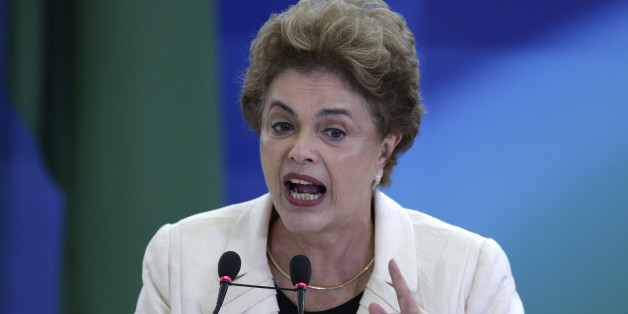 Brazil's President Dilma Rousseff speaks during a ceremony in which her predecessor, Luiz Inacio Lula da Silva, was sworn in as chief of staff, at the Planalto presidential palace, in Brasilia, Brazil, Thursday, March 17, 2016. Rousseff insisted Silva would help put the troubled country back on track and denounced attempts to oust her. (AP Photo/Eraldo Peres)