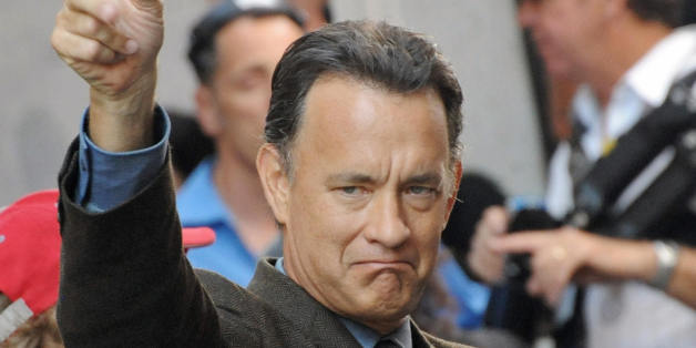US actor Tom Hanks gestures as he takes part in the shooting of the movie 'Angels and Demons' on June 9, 2008 at Piazza del Pantheon, in Rome. The film directed by Ron Howard is inspired by Dan Brown's best seller.   AFP PHOTO/ TIZIANA FABI (Photo credit should read TIZIANA FABI/AFP/Getty Images)