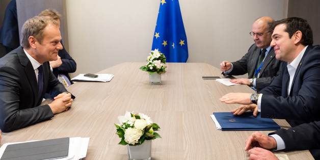 European Council President Donald Tusk, left, speaks with Greek Prime Minister Alexis Tsipras, right, during a meeting on the sidelines of an EU summit at the EU Council building in Brussels on Thursday, March 17, 2016. In the first day of a two-day summit, European Union leaders hope to seal a deal with Turkey to send back tens of thousands of migrants amid deep divisions over how to manage Europe's biggest refugee emergency in decades. (AP Photo/Geert Vanden Wijngaert, Pool)