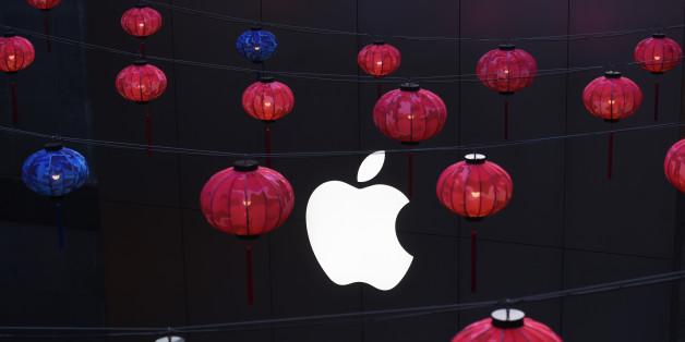 Devant un Apple Store à Pékin, le 23 février 2016. Ce 21 mars, Apple devrait dévoiler un nouvel iPhone SE.