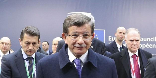 BRUSSELS, BELGUM - MARCH 18: Prime Minister of Turkey Ahmet Davutoglu delivers a speech during a press briefing as he attends the EU leaders summit at Headquarters of European Council in Brussels, Belgium on March 18, 2016. (Photo by Halil Sagirkaya/Anadolu Agency/Getty Images)