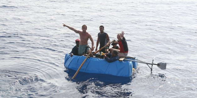 ATLANTIC OCEAN - JULY  2007:  Cubans 30 miles off the coast of the United States try to reach Florida in a tiny boat on July 30, 2007 in the Atlantic Ocean.  (Photo by Ronald C. Modra/Sports Imagery/Getty Images)