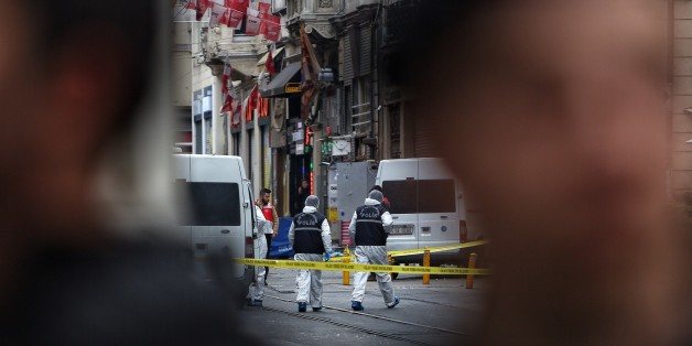ISTANBUL, TURKEY - MARCH 19:  Police secure the area as forensics inspects the blast site following a suicide bombing in a major shopping and tourist district in the central part of the city on March 19, 2016 in Istanbul, Turkey. The explosion on Istanbul's main pedestrian shopping Istiklal street today killed at least four people and left many injured. (Photo by Burak Kara/Getty Images)