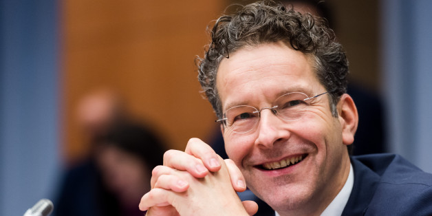 Dutch Finance Minister and chair of the eurogroup finance ministers Jeroen Dijsselbloem smiles as he arrives for an Eurogroup finance ministers meeting at the EU Council building in Brussels on Monday, Dec. 7, 2015. (AP Photo/Geert Vanden Wijngaert)