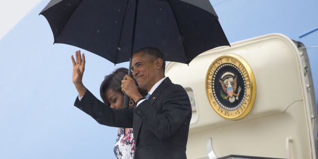President Barack Obama, right, arrives with first lady Michelle Obama as they exit Air Force One at the airport in Havana, Cuba, Sunday, March 20, 2016. Obama's trip is a crowning moment in his and Cuban President Raul Castro's ambitious effort to restore normal relations between their countries. (AP Photo/Pablo Martinez Monsivais)
