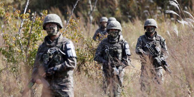 South Korean Army soldiers patrol during the demonstration of search operation at a training field near the demilitarized zone (DMZ) in Cheorwon, South Korea, Tuesday, Oct. 13, 2015. South Korea and North Korea are still technically at war because the 1950-53 Korean War ended with an armistice, not a peace treaty. (AP Photo/Lee Jin-man)