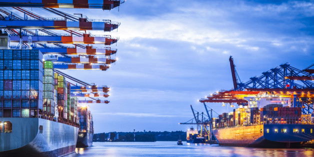 Container terminal with huge container cargo ship ready for unloading