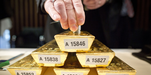 An employee of the German Federal Bank checks the core of a bar of gold during a press conference at the German Federal Bank in Frankfurt am Main, western Germany, on January 16, 2013.The German central Bundesbank said it will relocate parts of its gold stored abroad following recent accusations that it is not keeping proper track of its vast reserves.AFP PHOTO / FRANK RUMPENHORST   GERMANY OUT        (Photo credit should read FRANK RUMPENHORST/AFP/Getty Images)