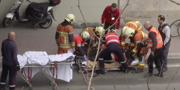 In this image made from video, emergency rescue workers stretcher an unidentified person at the site of an explosion at a metro station in Brussels, Belgium, March 22, 2016.   Explosions rocked the Brussels airport and the subway system Tuesday, just days after the main suspect in the November Paris attacks was arrested in the city, police said.(APTN via AP)