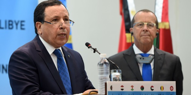 CORRECTION - UN envoy for Libya, Martin Kobler (L) speaks next to Tunisian Foreign Affairs Minister Khemais Jinnaoui during a press conference following the 8th ministerial meeting of Libya's neighbouring countries on March 22, 2016 in Tunis. Foreign ministers of neighbouring countries of conflict-wracked Libya are expected to meet together with Arab League chief and UN and EU officials. / AFP / FETHI BELAID / The erroneous mention[s] appearing in the metadata of this photo by FETHI BELAID has b