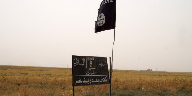 Islamic State group's flag is seen in an area after Kurdish troops known as peshmerga regained control of some villages west of the oil-rich city of Kirkuk, 180 miles (290 kilometers) north of Baghdad, Iraq, Wednesday, Sept. 30, 2015. Kurdish fighters in northern Iraq drove the IS group from more than 140 sq. kilometers (54 sq. miles) of territory near Kirkuk and cleared part of a major highway on Wednesday. (AP Photo)
