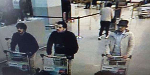 In this image provided by the Belgian Federal Police in Brussels on Tuesday, March 22, 2016 of three men who are suspected of taking part in the attacks at Belgium's Zaventem Airport. The man at right is still being sought by the police and two others in the photo that the police issued were according to a the Belgian Prosecutors 'probably' suicide bombers. Bombs exploded at the Brussels airport and one of the city's metro stations Tuesday, killing and wounding scores of people, as a European capital was again locked down amid heightened security threats. (Belgian Federal Police via AP)