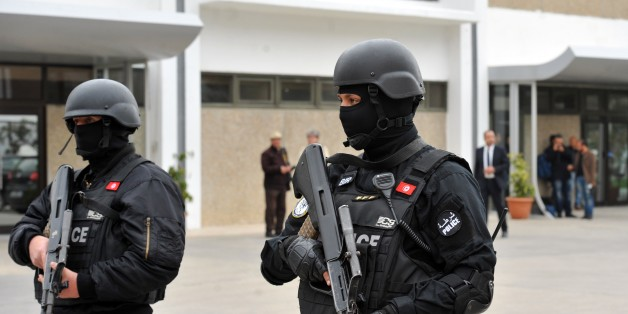 Members of Tunisian special forces stand guard outside Tunis-Carthage International airport on March 21, 2015 in Tunis, as security measures have been reinforced following the attack on Tunisia's National Bardo Museum. Was killed during the assault of the terrorist attack in Bardo Museum, two days after gunmen opened fire at visitors during an attack at the Bardo national museum. The Islamic State (IS) jihadist group claimed responsibility for the attack that killed at least 21 people. AFP PHOTO / FETHI BELAID        (Photo credit should read FETHI BELAID/AFP/Getty Images)