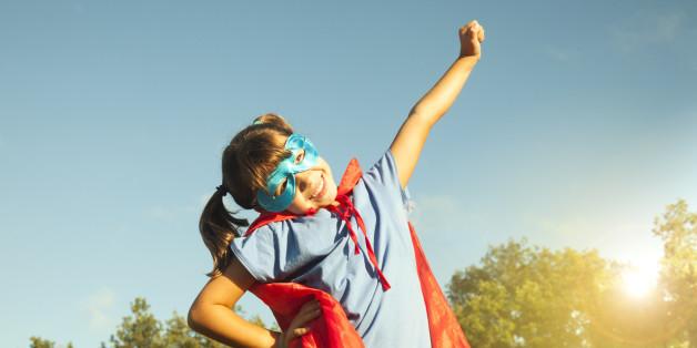 Little make believe super hero child,having fun,  seven years old, happy.