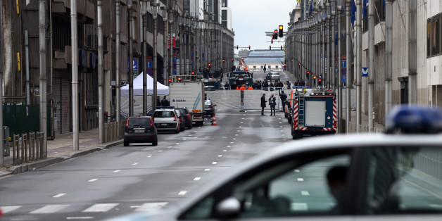 BRUSSELS, BELGIUM - MARCH 23:  A police car blocks a road near Maelbeek metro station following yesterday's attack, on March 23, 2016 in Brussels, Belgium. Belgium is observing three days of national mourning after 34 people were killed in a twin suicide blast at Zaventem Airport and a further bomb attack at Maelbeek Metro Station. Two brothers are thought to have carried out the airport attack and an international manhunt is underway for a third suspect. The attacks come just days after a key suspect in the Paris attacks, Salah Abdeslam, was captured in Brussels.  (Photo by Carl Court/Getty Images)