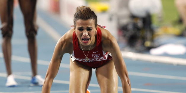 Tunisia's Habiba Ghribi reacts after placing second in the Women's 3000m Steeplechase final at the World Athletics Championships in Daegu, South Korea, Tuesday, Aug. 30, 2011. (AP Photo/Anja Niedringhaus)