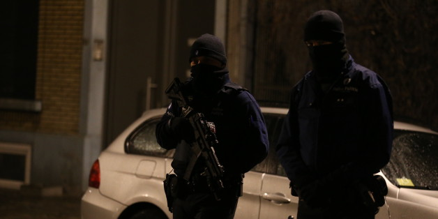 Police officers take part in an operation in Schaerbeek - Schaarbeek, Brussels, late on March 24, 2016. 