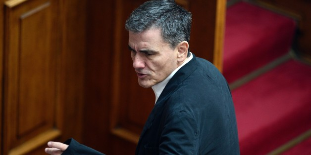 Greek Finance Minister Euclid Tsakalotos attends a committee meeting in the Greek parliament in Athens on July 22, 2015. Prime Minister Alexis Tsipras faced a new test of his authority in parliament on July 22, where MPs were to vote on a second batch of reforms to help unlock a bailout for Greece's stricken economy. The embattled premier last week faced a revolt by a fifth of the lawmakers in his radical-left Syriza party over changes to taxes, pensions and labour rules demanded by EU-IMF creditors.   AFP PHOTO / LOUISA GOULIAMAKI        (Photo credit should read LOUISA GOULIAMAKI/AFP/Getty Images)
