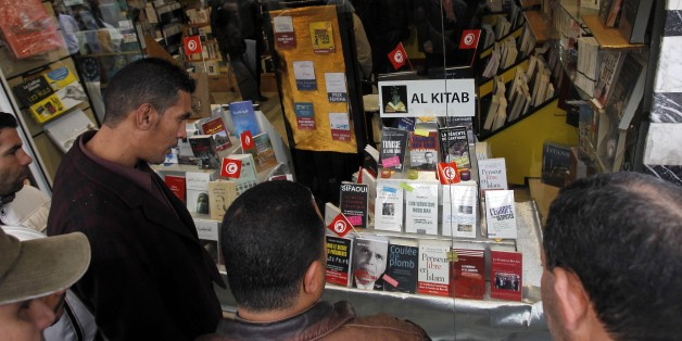 """People view uncensored books newly displayed in a Tunis book store, Tuesday, Jan. 25. 2011. Tunisia's so-called """"Jasmine Revolution"""" has sparked scattered protests and civil disobedience in the Middle East and North Africa, and much of the world is watching to see how the birth pangs of Tunisian democracy play out. (AP Photo/Christophe Ena)"""