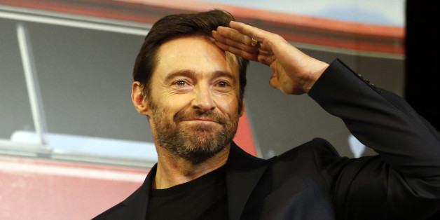 "Actor Hugh Jackman greets to the media upon his arrival for a press conference for his new movie ""Eddie The Eagle"" in Seoul, South Korea, Monday, March 7, 2016. The movie is to be released in South Korea on April 7. (AP Photo/Lee Jin-man)"