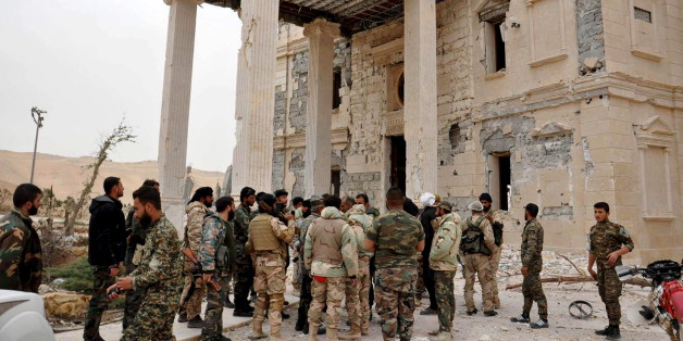 Forces loyal to Syria's President Bashar al-Assad gather at a palace complex on the western edge of Palmyra in this picture provided by SANA on March 24, 2016. REUTERS/SANA/Handout via Reuters ATTENTION EDITORS - THIS PICTURE WAS PROVIDED BY A THIRD PARTY. REUTERS IS UNABLE TO INDEPENDENTLY VERIFY THE AUTHENTICITY, CONTENT, LOCATION OR DATE OF THIS IMAGE. FOR EDITORIAL USE ONLY. NOT FOR SALE FOR MARKETING OR ADVERTISING CAMPAIGNS. THIS PICTURE IS DISTRIBUTED EXACTLY AS RECEIVED BY REUTERS, AS A