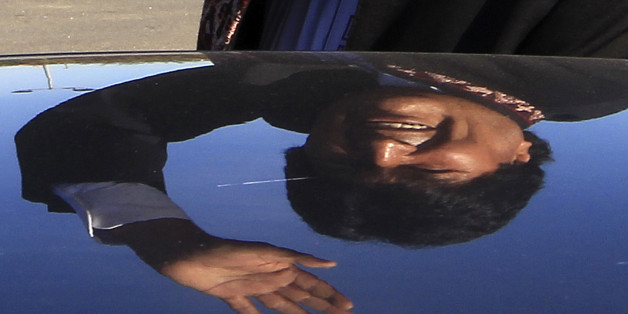 Bolivia's President Evo Morales is reflected on a car as he waves while leaving a charity event, in  Lescar, near Pau, southwestern France, Saturday, Nov. 7, 2015. Morales is on a two day visit to France and will meet with French President Francois Hollande in Paris on Monday. (AP Photo/Bob Edme)