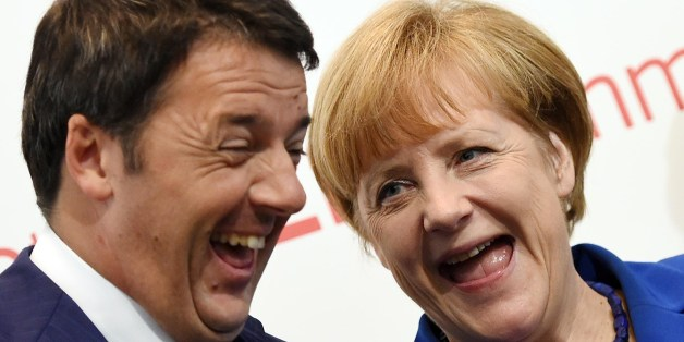 German Chancellor Angela Merkel (R) and Italian Prime Minister Matteo Renzi smile during the 10th Asia-Europe Meeting (ASEM) on October 16, 2014 in Milan. The Asia-Europe Meeting (ASEM) was created in 1996 as a forum for dialogue and cooperation between Europe and Asia held every two years alternatively in Asia and Europe.   AFP PHOTO / DANIEL DAL ZENNARO        (Photo credit should read DANIEL DAL ZENNARO/AFP/Getty Images)